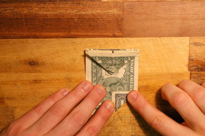 Folded dollar bill from right bottom corner.
