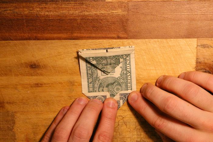 Fold tip of folded bottom right corner.