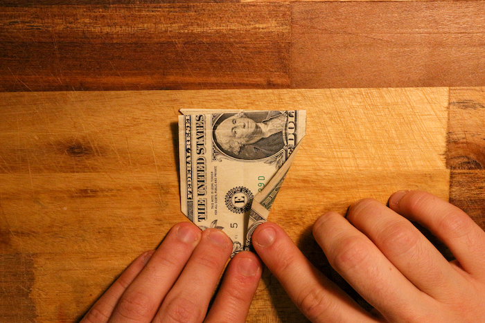 Fold the bottom right flap up until it meets the center of the bill.