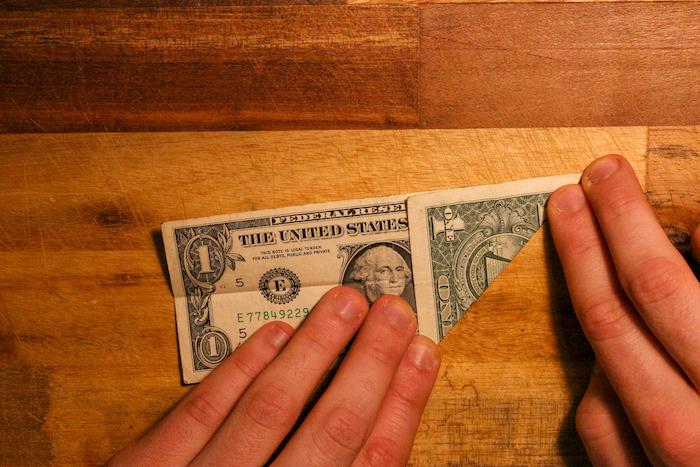 Fold a dollar from one corner.