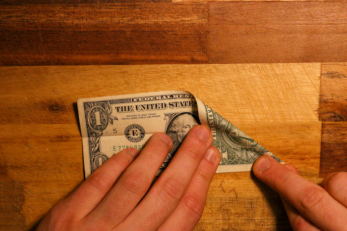 Fold dollar from other end.