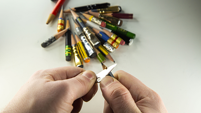Sharpening pencils with knife.