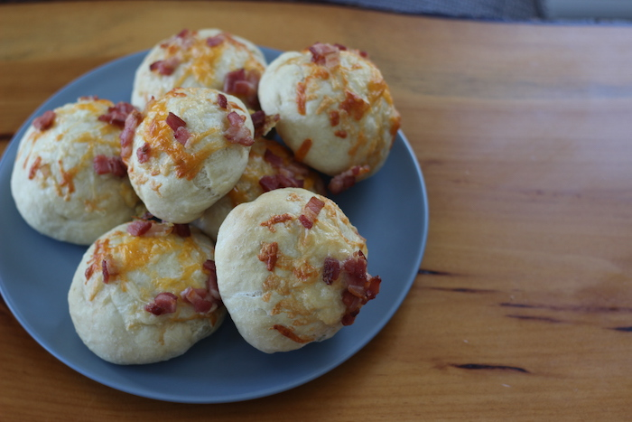 Tasty cheese bacon rolls being served.