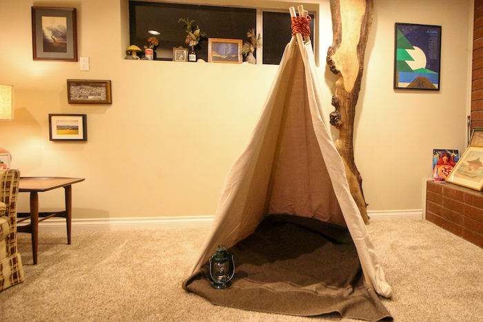 Teepee placed in a room.