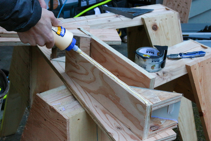 Gluing the side of plywood.