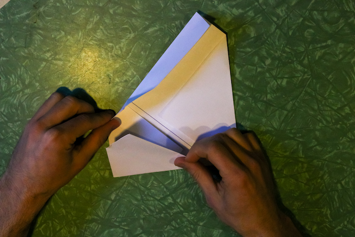 Squaring the corners of the paper by hands.