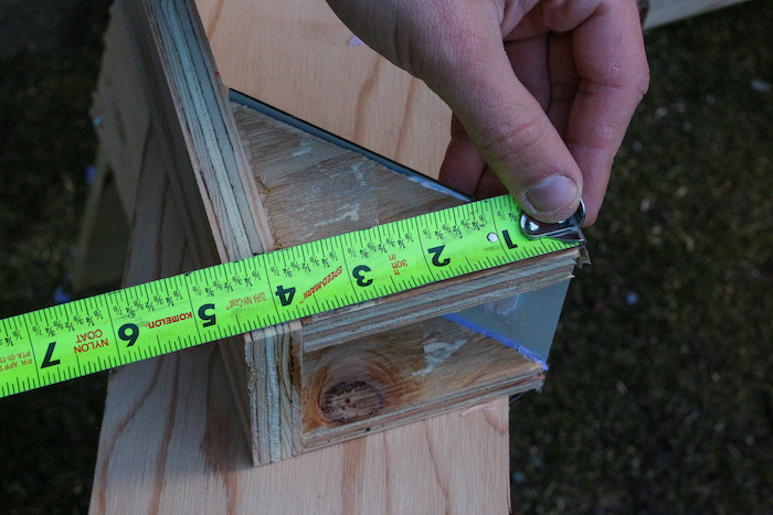 Measuring plywood with scale.