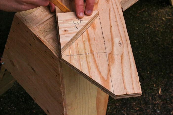 Cutting plywood in triangular shape.