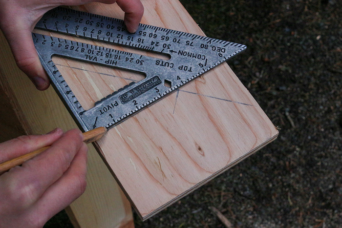 Measurements done on plywood with the help of protractor.