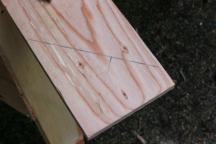 Mark drawn on plywood.