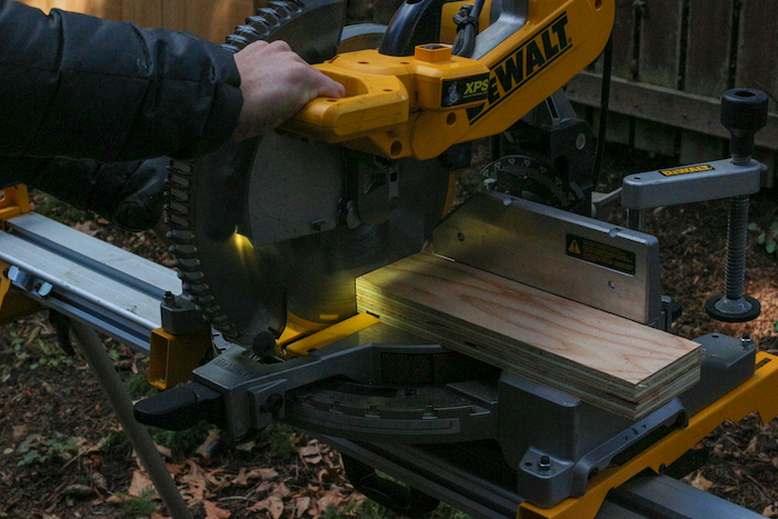 Cutting plywood with machine.
