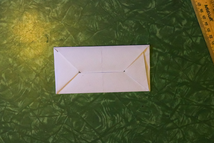 Envelope placed on table.