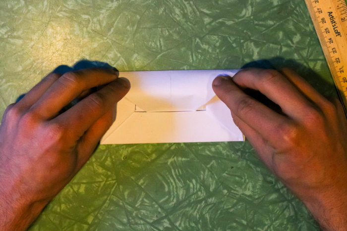 Wrapping up the envelope with hands.