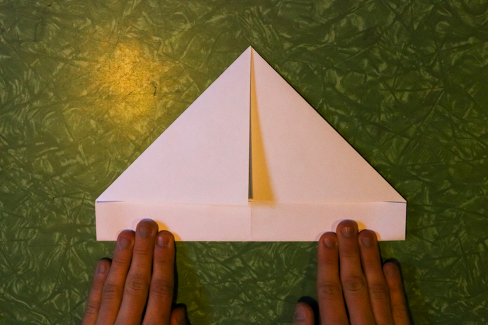 Making triangle from paper by Folding.