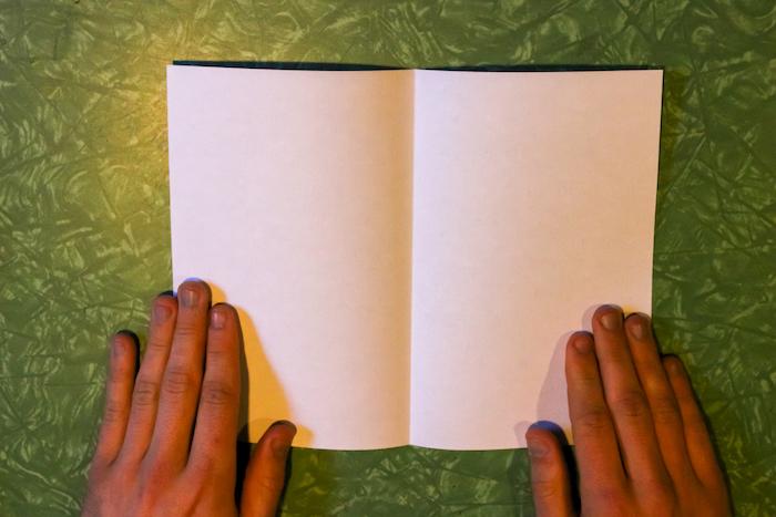 Both hands kept on paper.