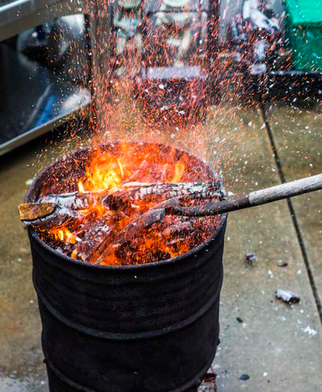 Burning of woods in a drum.