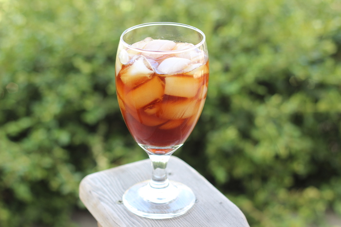 Cold brew coffee with ice cubes served in glass.
