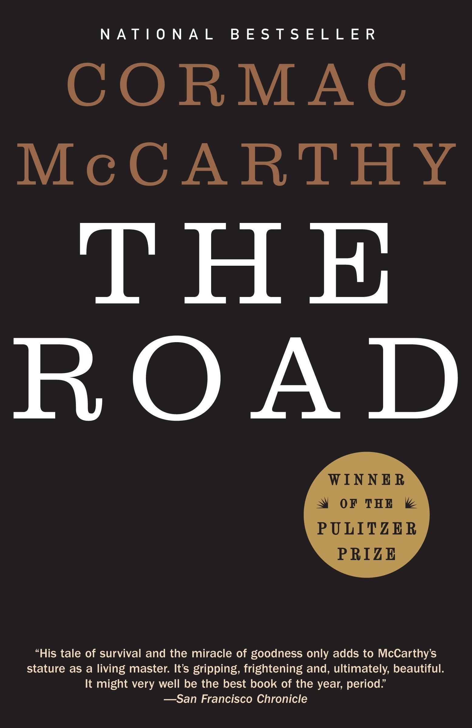 """A book cover of """"The Road"""" by Cormac McCarthy."""