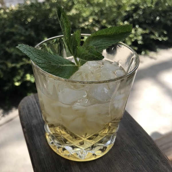 Mint Julep and ice cubes in a glass.