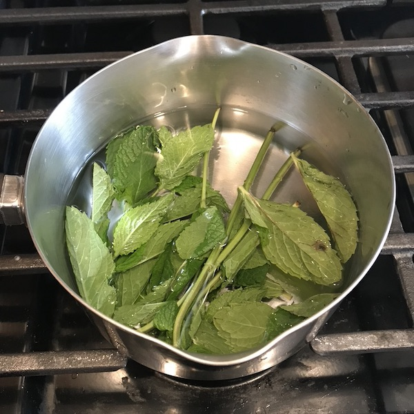 Mint and water in a pot.