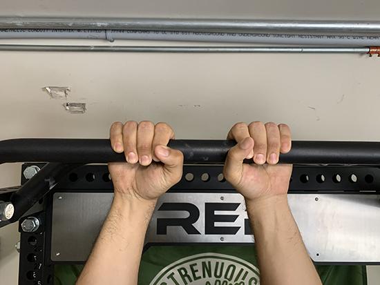 Man hanging with narrow grip.