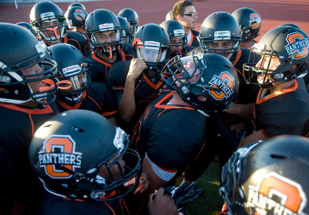 Football orange team cheering.