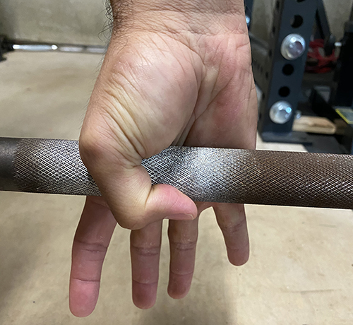 Step1: Wrap your thumb around the bar first.