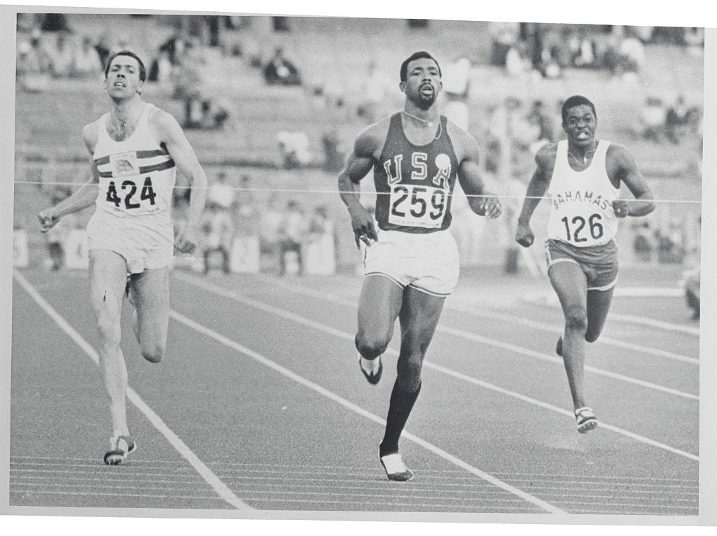 Olympic medalist John Carlos running during race.