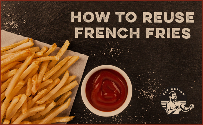 French fries with a bowl of ketchup on a table.