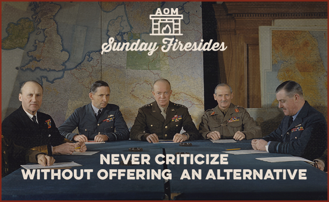 General Dwight D. Eisenhower sitting with his staff to study certain problems during War II.