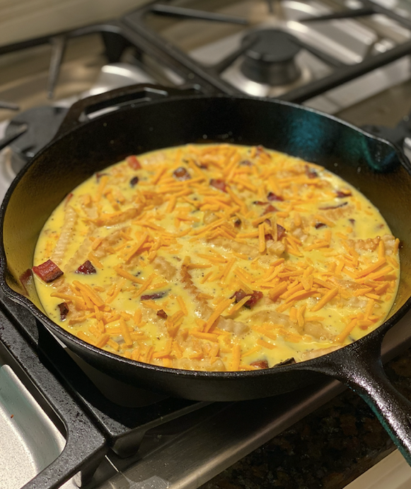 Making of Frittata with leftover fries in fryingpan.