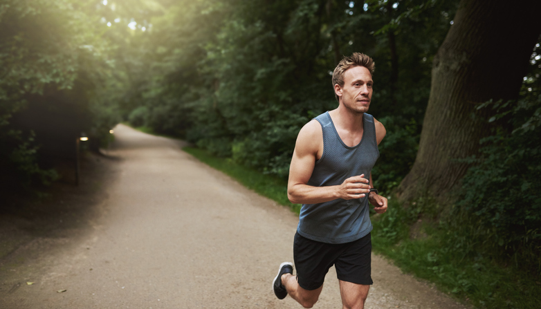 A man jogging on a track.