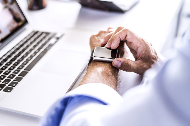A man with wearing smart watch.