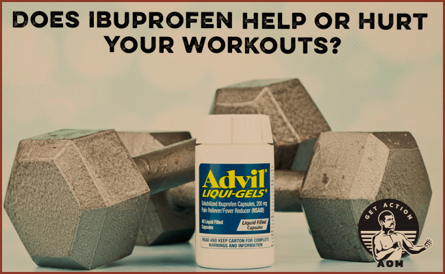 Advil container in front of dumbbells.