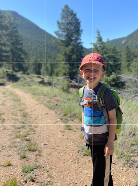 Young boy on a trail with photo grid lines overlaid.