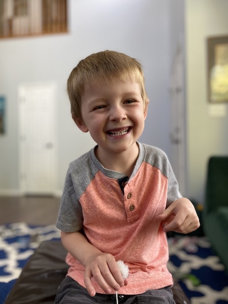 Smiling 5-year-old boy.