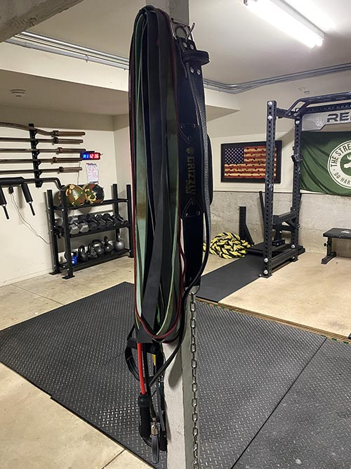 hooks mounted on a pillar to hang jump ropes, belt, resistance bands, and more.