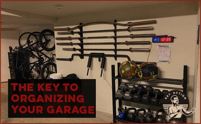 garage gym organized with dumbells and barbells on racks.
