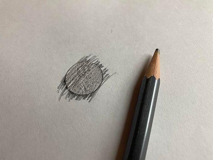pencil rubbing of a coin.