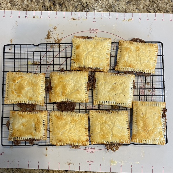 cooked pop tarts cooling on a rack.