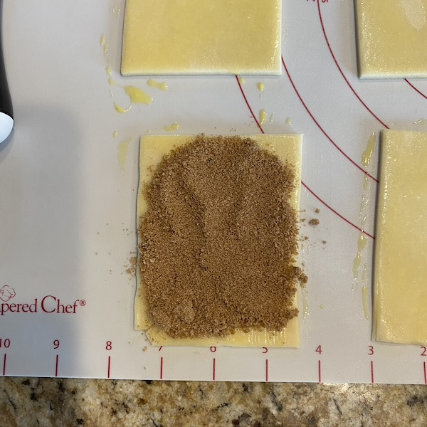 adding filling to pop tart rectangles.